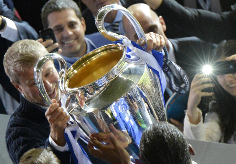 Chelsea owner Roman Abramovich celebrates with the trophy at the end of the Champions League final soccer match between Bayern Munich and Chelsea in Munich, Germany Saturday May 19, 2012. Chelsea's Didier Drogba scored the decisive penalty in the shootout as Chelsea beat Bayern Munich to win the Champions League final after a dramatic 1-1 draw on Saturday. (AP Photo/Kerstin Joensson)