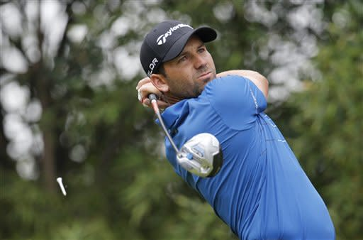 Spain's Sergio Garcia tees off the 2nd hole during the third round of the HSBC Champions golf tournament at the Sheshan International Golf Club in Shanghai, China, Saturday, Nov. 2, 2013. (AP Photo/Eugene Hoshiko)