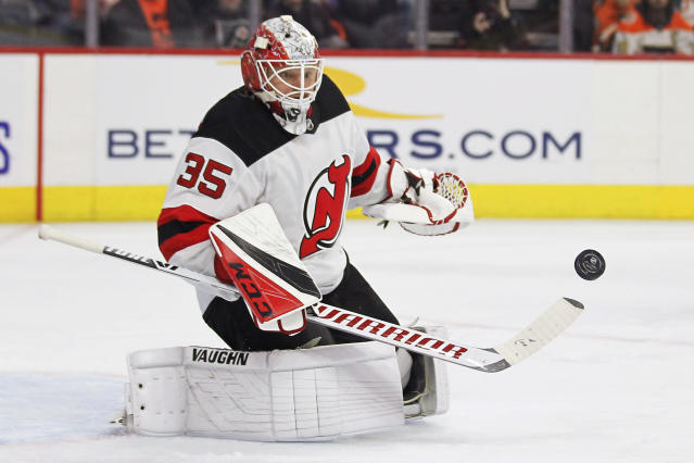 New Jersey Devils' Cory Schneider deflects a shot during the second period of the team's NHL hockey game against the Philadelphia Flyers on Wednesday, Oct. 9, 2019, in Philadelphia. (AP Photo/Tom Mihalek)