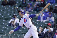 Chicago Cubs' Matt Duffy watches his sacrifice fly off Pittsburgh Pirates starting pitcher Trevor Cahill during the third inning of a baseball game against the Pittsburgh Pirates on Friday, May 7, 2021, in Chicago. Javier Baez scored on the play. (AP Photo/Charles Rex Arbogast)