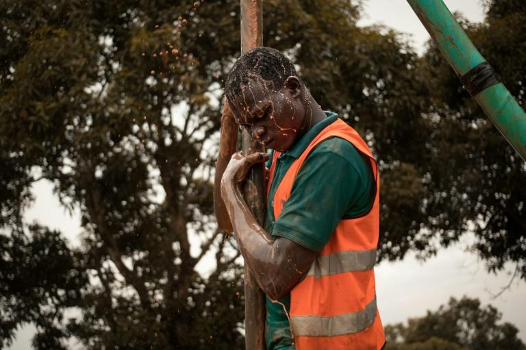 A former child soldier works on drilling a borehole in Bangui, part of a vocational programme for young victims of the Central African Republic's long conflict (AFP Photo/FLORENT VERGNES)
