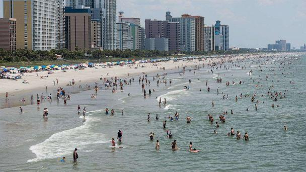 PHOTO: People wade in the ocean on July 4, 2020, in Myrtle Beach, S.C. (Sean Rayford/Getty Images)