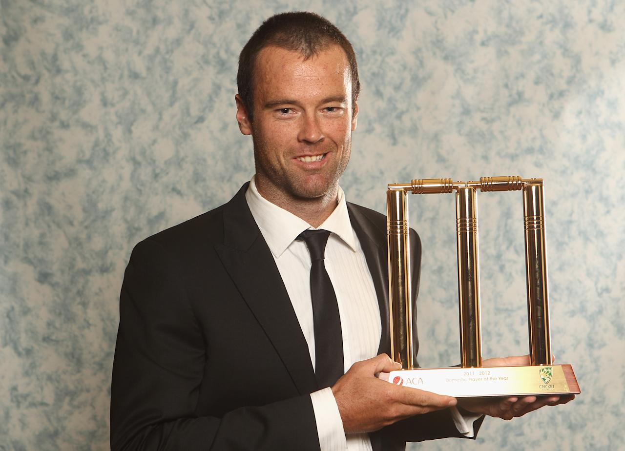 MELBOURNE, AUSTRALIA - FEBRUARY 27:  Rob Quiney poses with the Domestic Player of the Year trophy during the 2012 Allan Border Medal Awards at Crown Palladium on February 27, 2012 in Melbourne, Australia.  (Photo by Lucas Dawson/Getty Images)