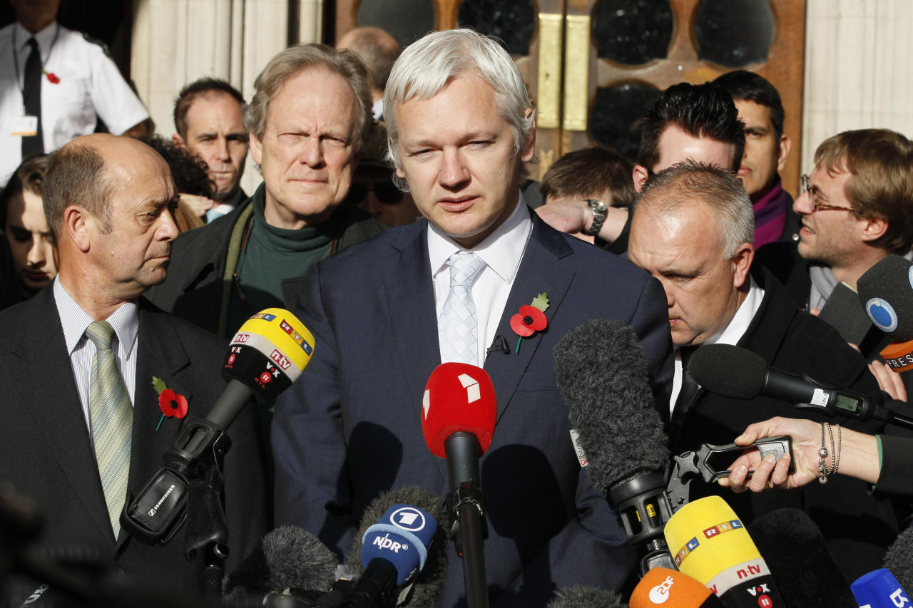 The founder of WikiLeaks Julian Assange, center, gives a statement to the media after his extradition hearing at the High Court in London, Wednesday, Nov. 2, 2011. Assange on Wednesday lost his appeal against extradition to Sweden to answer sex crime allegations, but may now take his protracted fight to Britain's highest court. (AP Photo/Kirsty Wigglesworth)