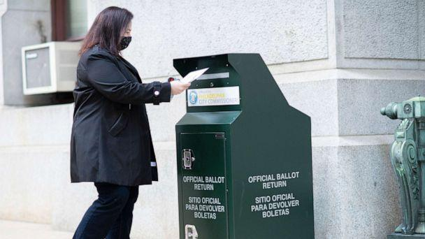 PHOTO: A voter casts her early voting ballot at drop box outside of City Hall, Oct. 17, 2020, in Philadelphia. (Mark Makela/Getty Images)