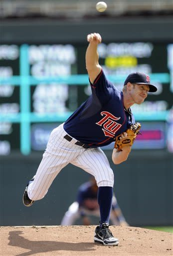 Minnesota Twins pitcher Cole DeVries throws against the Detroit Tigers in the first inning of a baseball game, Wednesday, Aug. 15, 2012, in Minneapolis. (AP Photo/Jim Mone)