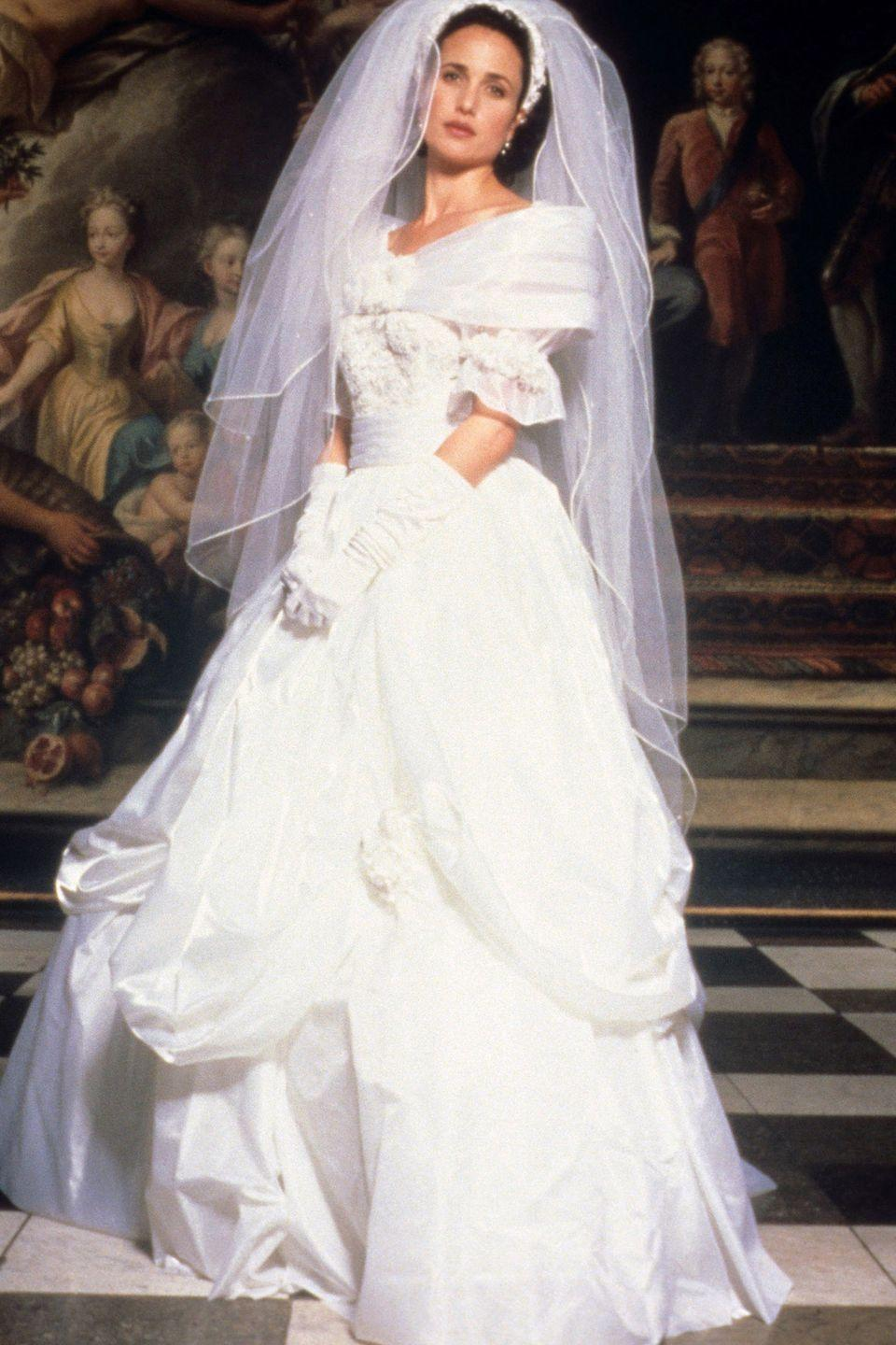 <p>In one of the four weddings that took place in <em>Four Weddings and a Funeral</em><em>,</em> Carrie (Andie MacDowell) wore an off-the-shoulder, A-line ball gown with a draped skirt.<br></p>