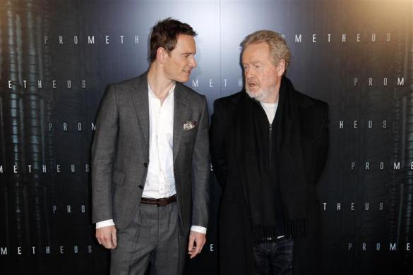 """Michael Fassbender and director Ridley Scott as they arrive at the French premiere of the movie """"Prometheus"""" in Paris, April 11, 2012."""