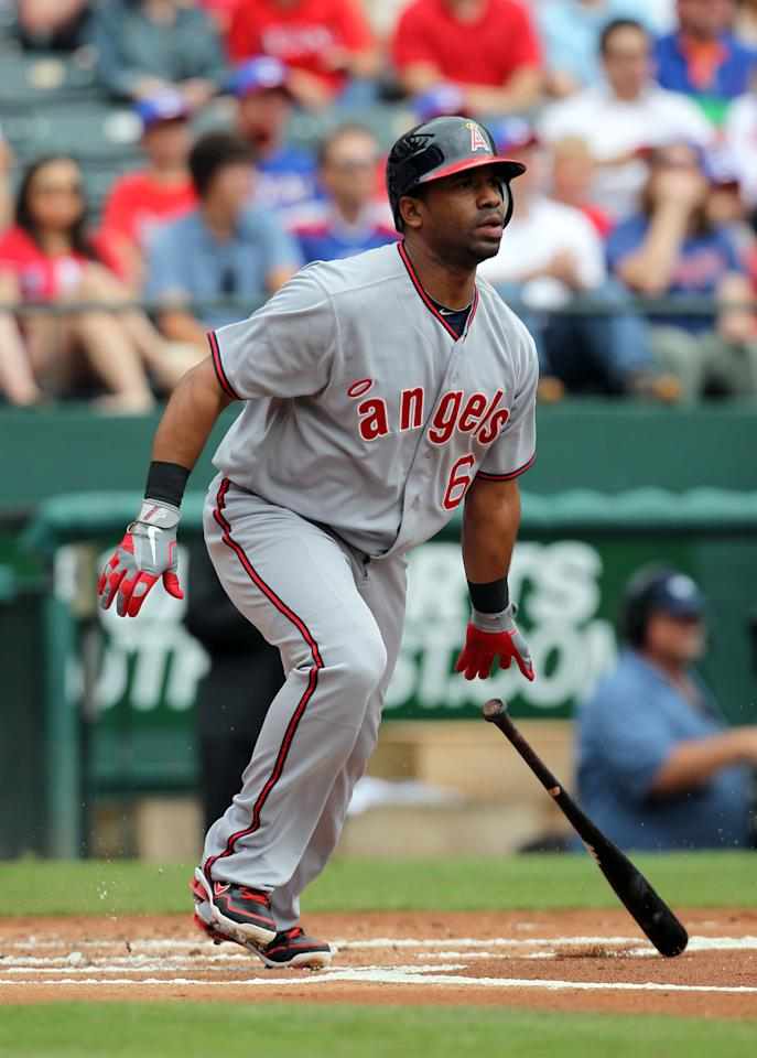ARLINGTON, TX - MAY 12: Alberto Callaspo of the Los Angeles Angels of Anaheim watches the flight of his ball against the Texas Rangers on May 12, 2012 in Arlington, Texas. (Photo by Layne Murdoch/Getty Images)