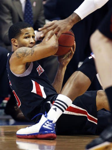 Texas Tech guard Javarez Willis (5) looks for an open teammate during the first half of an NCAA college basketball game against Kansas in Lawrence, Kan., Saturday, Feb. 18, 2012. (AP Photo/Orlin Wagner)