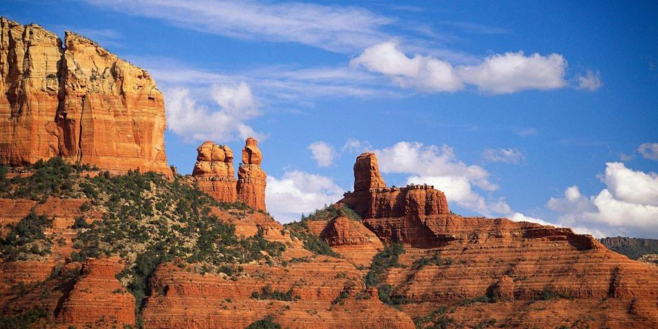 """<p><strong>Best for Desert Scenery </strong></p><p>You'll never get over marveling at the beauty of the Red Rocks of Sedona — they're that awe-inspiring. Get up-close and personal with these rust-hued mesas and buttes via <a href=""""https://go.redirectingat.com?id=74968X1596630&url=https%3A%2F%2Fwww.tripadvisor.com%2FAttraction_Review-g31352-d109696-Reviews-Pink_Jeep_Tours_Sedona-Sedona_Arizona.html&sref=https%3A%2F%2Fwww.countryliving.com%2Flife%2Fg37186621%2Fbest-places-to-experience-and-visit-in-the-usa%2F"""" rel=""""nofollow noopener"""" target=""""_blank"""" data-ylk=""""slk:Jeep tour"""" class=""""link rapid-noclick-resp"""">Jeep tour</a>, then head to one of Sedona's vortexes to soak up some positive vibes. (Using healing crystals and getting an aura photo is optional.)</p><p><strong><em>Where to Stay:</em></strong> <a href=""""https://go.redirectingat.com?id=74968X1596630&url=https%3A%2F%2Fwww.tripadvisor.com%2FHotel_Review-g31352-d75461-Reviews-Hilton_Sedona_Resort_at_Bell_Rock-Sedona_Arizona.html&sref=https%3A%2F%2Fwww.countryliving.com%2Flife%2Fg37186621%2Fbest-places-to-experience-and-visit-in-the-usa%2F"""" rel=""""nofollow noopener"""" target=""""_blank"""" data-ylk=""""slk:Hilton Sedona Resort at Red Rock"""" class=""""link rapid-noclick-resp"""">Hilton Sedona Resort at Red Rock</a>, <a href=""""https://go.redirectingat.com?id=74968X1596630&url=https%3A%2F%2Fwww.tripadvisor.com%2FHotel_Review-g31352-d115335-Reviews-L_Auberge_de_Sedona-Sedona_Arizona.html&sref=https%3A%2F%2Fwww.countryliving.com%2Flife%2Fg37186621%2Fbest-places-to-experience-and-visit-in-the-usa%2F"""" rel=""""nofollow noopener"""" target=""""_blank"""" data-ylk=""""slk:L'Auberge de Sedona"""" class=""""link rapid-noclick-resp"""">L'Auberge de Sedona</a></p><p><strong>More: </strong><a href=""""https://www.bestproducts.com/tech/gadgets/a13958052/reviews-best-360-degree-video-camera/"""" rel=""""nofollow noopener"""" target=""""_blank"""" data-ylk=""""slk:Best 360 Cameras for Snapping Remarkable Sunsets"""" class=""""link rapid-noclick-resp"""">Best 360 Cameras for Snapping Remarkable Sunsets</a><br></"""