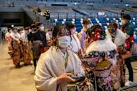 """Twenty-year-old women dressed in kimono attend a """"Coming-of-Age Day"""" celebration ceremony at Yokohama Arena"""