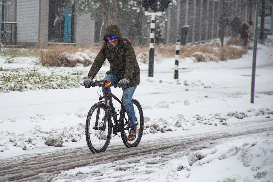 A man cycling a bike on the snow covered bicycle lane. Blizzard from snow storm Darcy hits the Netherlands, the first heavy snowfall with intense strong winds after 2010. The country woke up on Sunday with a layer of snow covering everything. Many accidents occurred on the Dutch roads due to the storm and the icy condition, while there was a problem with trains as well. In the city of Eindhoven in North Brabant, rail and bus services stopped operating, the airport followed and air traffic was diverted. People went outside in the city center of Eindhoven to enjoy the white scenery and some used their sleigh. According to the forecast, the cold winter weather with subzero freezing conditions and the snowstorm will continue the following days, expecting temperatures below -10 C. (Photo by Nik Oiko / SOPA Images/Sipa USA)