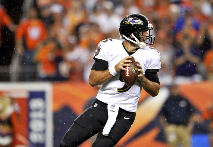 Baltimore Ravens quarterback Joe Flacco looks to throw in the rain against the Denver Broncos during the first half of an NFL football game, Thursday, Sept. 5, 2013, in Denver. (AP Photo/Jack Dempsey)