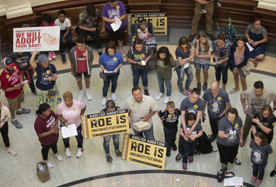 FILE - In this March 30, 2021, file photo, pro-life demonstrators gather in the rotunda at the Capitol while the Senate debated anti-abortion bills in Austin, Texas. Even before a strict abortion ban took effect in Texas this week, clinics in neighboring states were fielding more and more calls from women desperate for options. The Texas law, allowed to stand in a decision Thursday, Sept. 2, 2021 by the U.S. Supreme Court, bans abortions after a fetal heartbeat can be detected, typically around six weeks. (Jay Janner/Austin American-Statesman via AP, File)