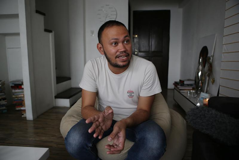 "In this photo taken on May 8, 2013, Filipino director Borinaga Alix Jr. talks during an interview inside his home in suburban Quezon city, north of Manila, Philippines. Alix could have shot his film ""Death March"" on location in a large-scale production, but instead chose to film it in black-and-white and almost entirely inside a studio using hand-painted backdrops, with close-ups of actors' painted faces portraying their struggles with nightmares and hallucinations in one of the bloodiest episodes of World War II. (AP Photo/Aaron Favila)"