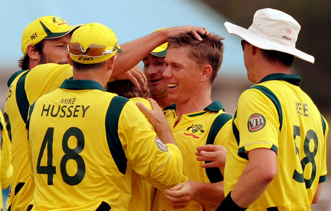 Australian cricketer Xavier Doherty (C) celebrates with teammates after dismissing West Indies batsman Adrian Barath during the fifth-of-five One-Day International (ODI) matches between West Indies and Australia at the Beausejour Cricket Ground in Gros Islet on March 25, 2012.     AFP PHOTO/Jim Watson (Photo credit should read JIM WATSON/AFP/Getty Images)