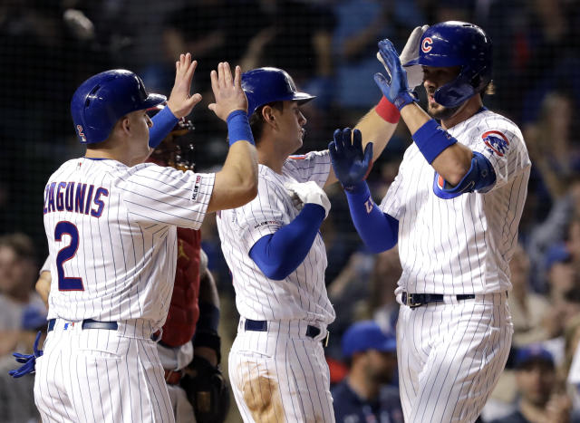 Chicago Cubs' Kris Bryant, right, celebrates with Albert Almora Jr., center, and Mark Zagunis after hitting a grand slam during the eighth inning of a baseball game against the St. Louis Cardinals, Sunday, May 5, 2019, in Chicago. (AP Photo/Nam Y. Huh)