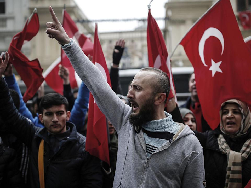 Dutch police used dogs and water cannons to disperse hundreds of protesters who gathered outside the Turkish consulate in Rotterdam: AP