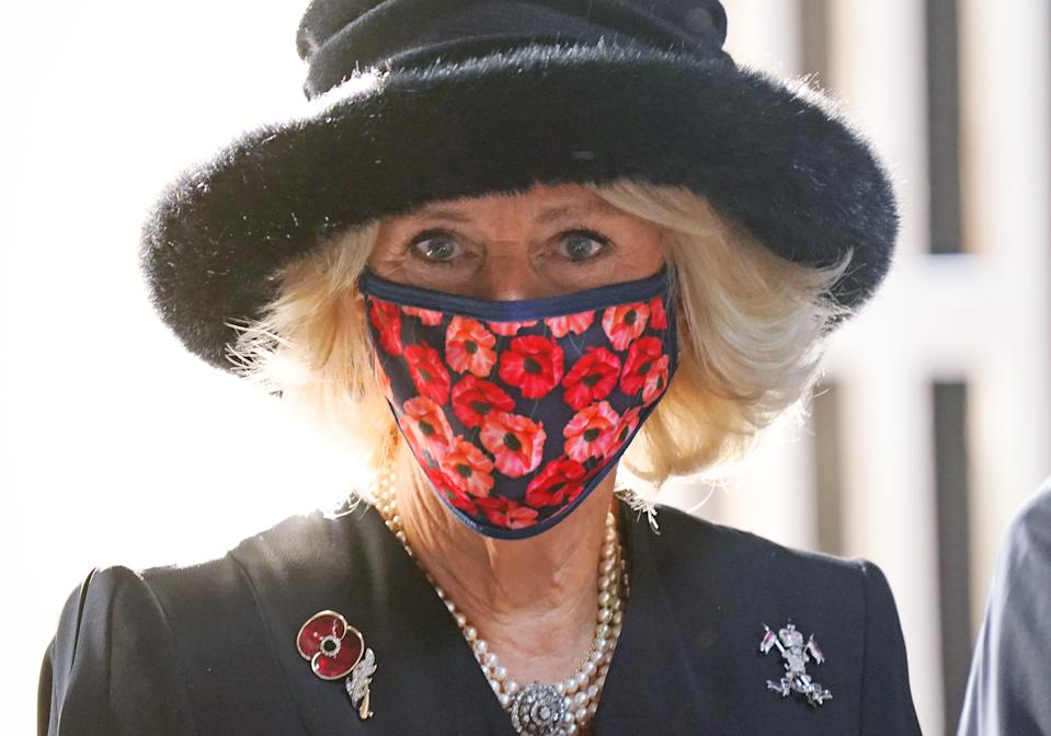 BERLIN, GERMANY - NOVEMBER 15: Camilla, Duchess of Cornwall, wears a poppy-themed face mask while visiting the Neue Wache memorial to victims of war and tyranny with Prince Charles (not seen) on November 15, 2020 in Berlin, Germany. The British royal couple are in Berlin to attend events today on Germany's National Day of Mourning that commemorates victims of war and fascism. Prince Charles is set to give a speech at the Bundestag later. (Photo by Sean Gallup/Getty Images)