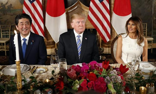 """<span class=""""element-image__caption"""">Donald and Melania Trump host Shinzo Abe and his wife, Akie Abe, for dinner at Trump's private Mar-a-Lago club.</span> <span class=""""element-image__credit"""">Photograph: Pablo Martinez Monsivais/AP</span>"""