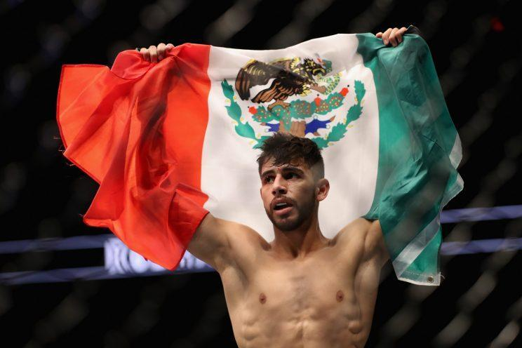 Yair Rodriguez celebrates his second-round TKO over B.J. Penn Sunday in Phoenix. (Getty Images)
