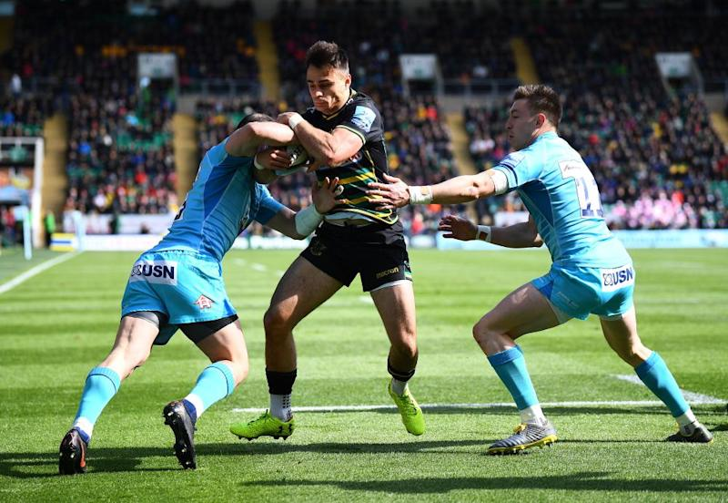Northampton's Tom Collins tries to escape the attentions of two Worcester defenders.