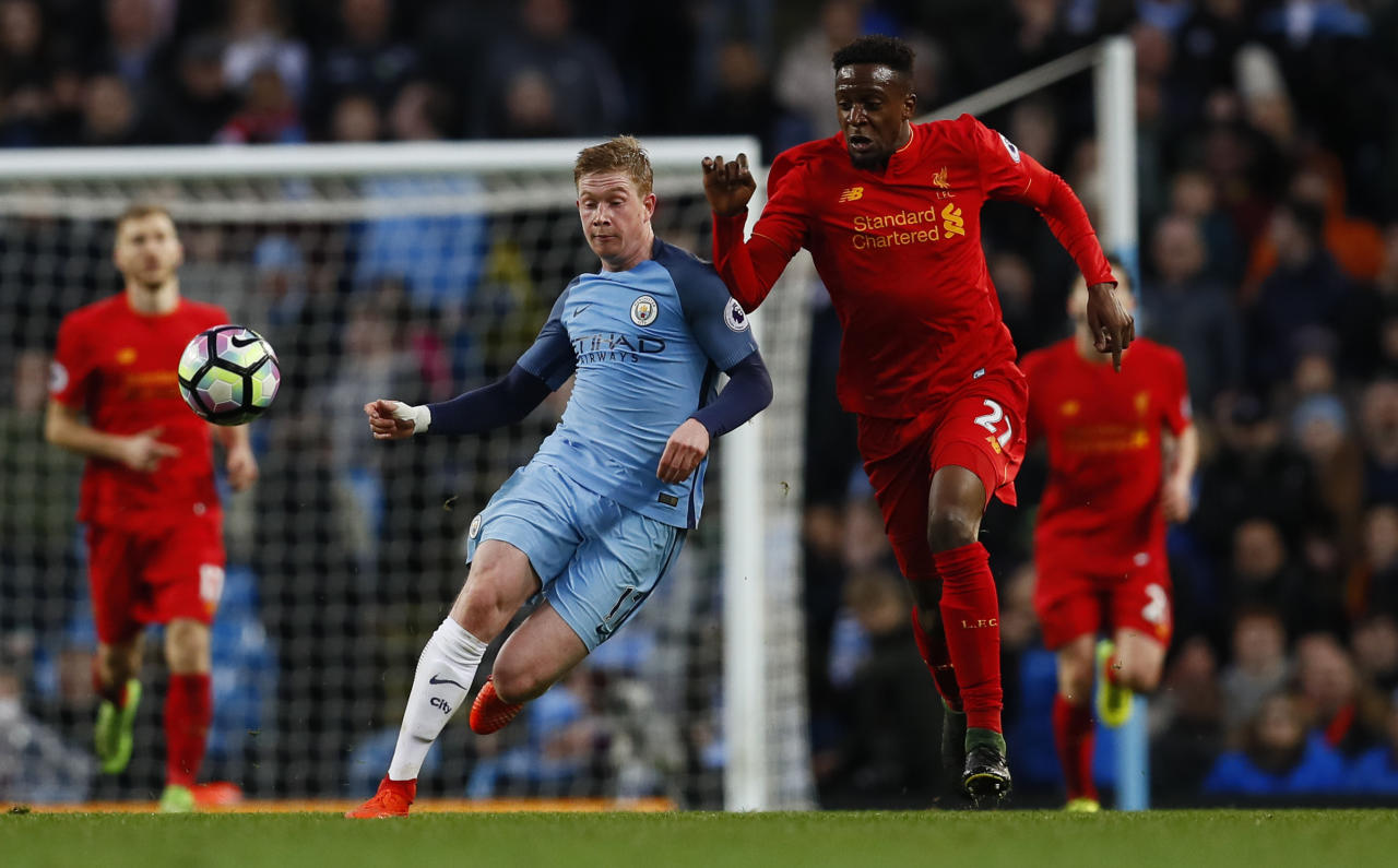 "Britain Soccer Football - Manchester City v Liverpool - Premier League - Etihad Stadium - 19/3/17 Liverpool's Divock Origi in action with Manchester City's Kevin De Bruyne  Action Images via Reuters / Jason Cairnduff Livepic EDITORIAL USE ONLY. No use with unauthorized audio, video, data, fixture lists, club/league logos or ""live"" services. Online in-match use limited to 45 images, no video emulation. No use in betting, games or single club/league/player publications.  Please contact your account representative for further details."