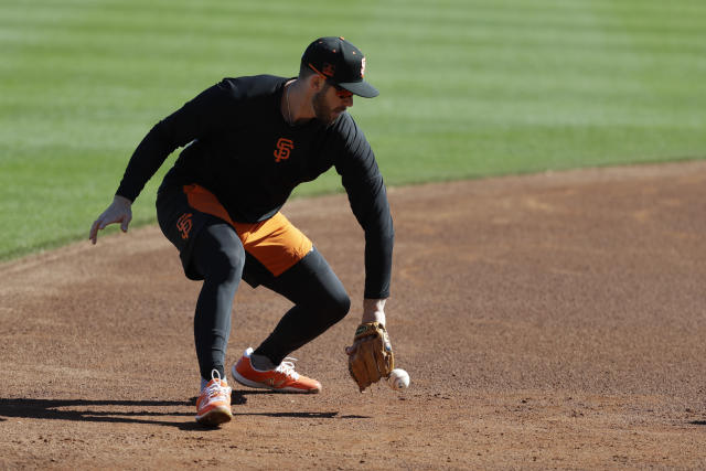 San Francisco Giants' Evan Longoria fields a ground ball during spring training baseball practice, Friday, Feb. 14, 2020, in Scottsdale, Ariz. (AP Photo/Darron Cummings)