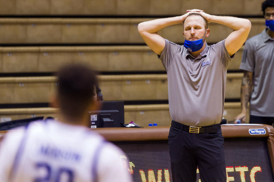 Drake head coach Darian DeVries reacts as his team falls behind in the second half of an NCAA college basketball game against Valparaiso, Sunday, Feb. 7, 2021, in Valparaiso, Ind. (AP Photo/Robert Franklin)