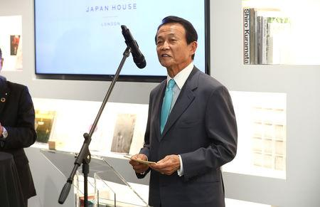 FILE PHOTO - Taro Aso, Japan's Deputy Prime Minister, speaks at the official opening of Japan House in London