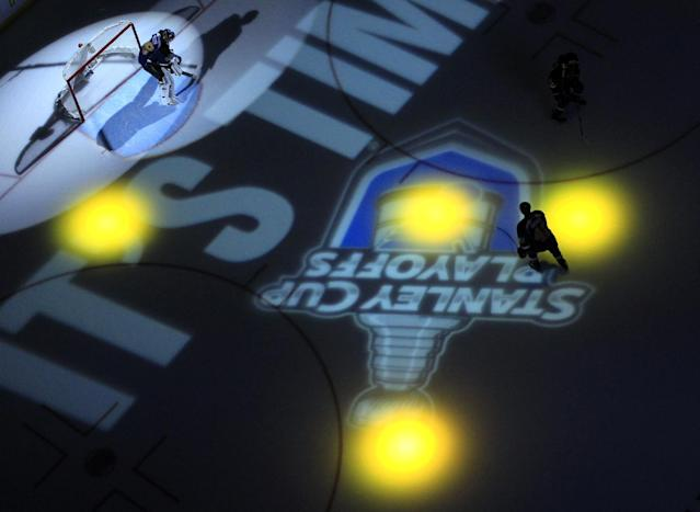 St. Louis Blues goalie Ryan Miller, left, and teammate David Backes prepare fore Game 1 of a first-round NHL hockey Stanley Cup playoff series against the Chicago Blackhawks on Thursday, April 17, 2014, in St. Louis. (AP Photo/Jeff Roberson)