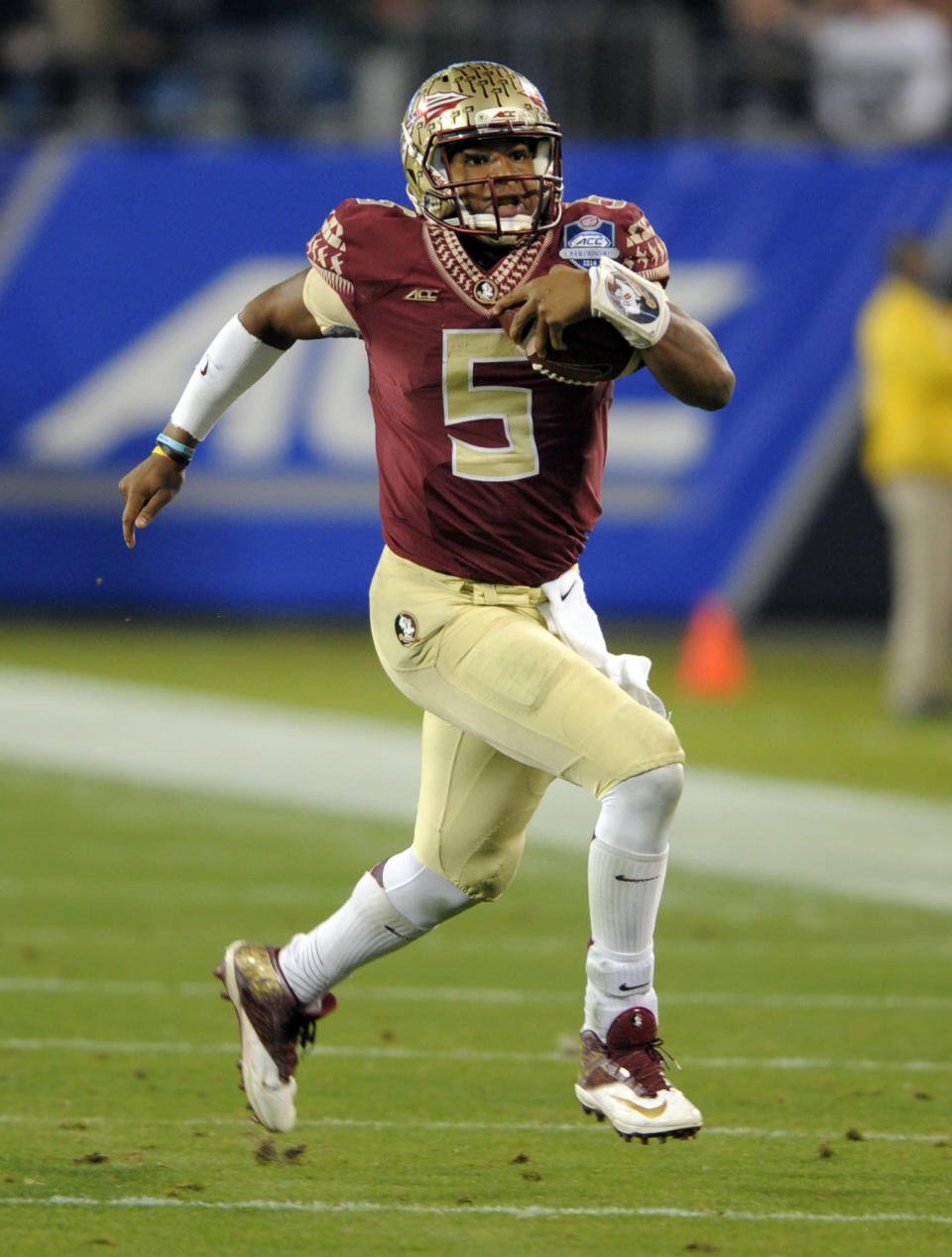 Florida State quarterback Jameis Winston (5) scrambles for a long gain against Georgia Tech during the first half of the Atlantic Coast Conference championship NCAA college football game in Charlotte, N.C., Saturday, Dec. 6, 2014. (AP Photo/Mike McCarn)