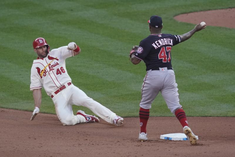 St. Louis Cardinals' Paul Goldschmidt is out at second as Washington Nationals' Howie Kendrick turns a double play on a ball hit by Yadier Molina during the seventh inning of Game 2 of the baseball National League Championship Series Saturday, Oct. 12, 2019, in St. Louis. (AP Photo/Charlie Riedel)