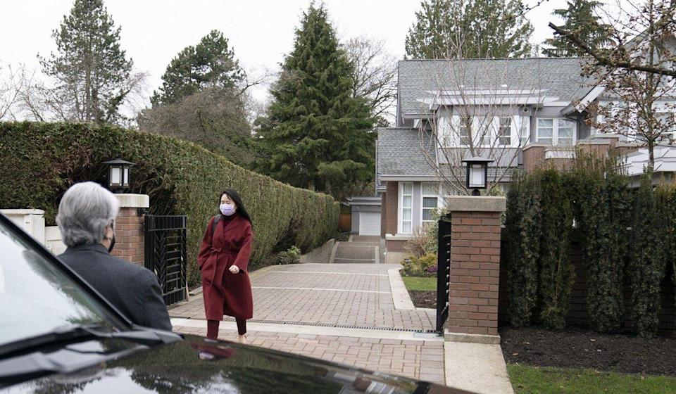 Meng Wanzhou leaves her home in Vancouver on Thursday. Photo: AP