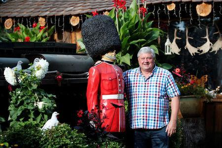 """Gary Blackburn, a 53-year-old tree surgeon from Lincolnshire, Britain, poses with a model of the Queen's Coldstream Guard at his British curiosities collection called """"Little Britain"""" in Linz-Kretzhaus, south of Germany's former capital Bonn, Germany, September 4, 2017. REUTERS/Wolfgang Rattay"""
