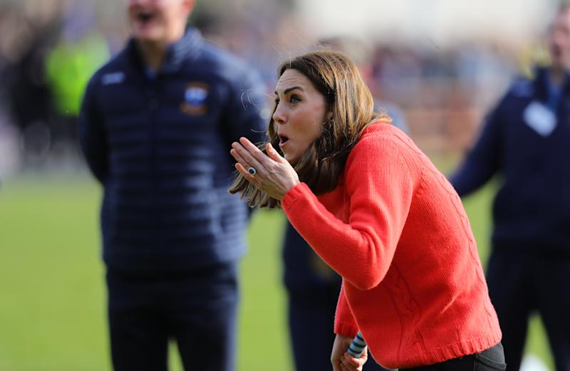 The Duchess of Cambridge tries her hand at Hurling as part of her visit to Salthill Knocknacarra GAA Club in Galway on the third day of her their visit to the Republic of Ireland. (Photo by Aaron Chown/PA Images via Getty Images)