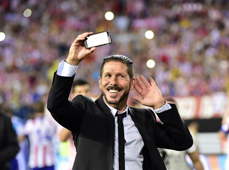 Atletico Madrid's coach Diego Simeone celebrates after winning the Spanish Super Cup title, at the end of their second-leg match against Real Madrid, at the Vicente Calderon Stadium in Madrid, on August 22, 2014 (AFP Photo/Gerard Julien)