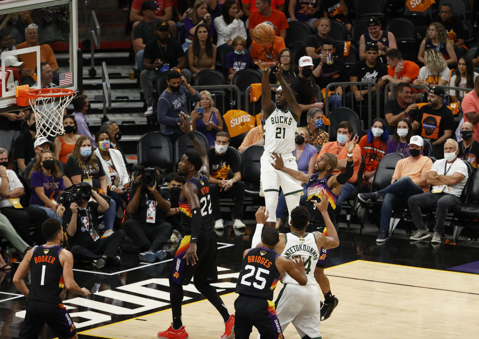 Seen here, Milwaukee star Jrue Holiday shoots against the Phoenix Suns in Game 5 of the NBA Finals.