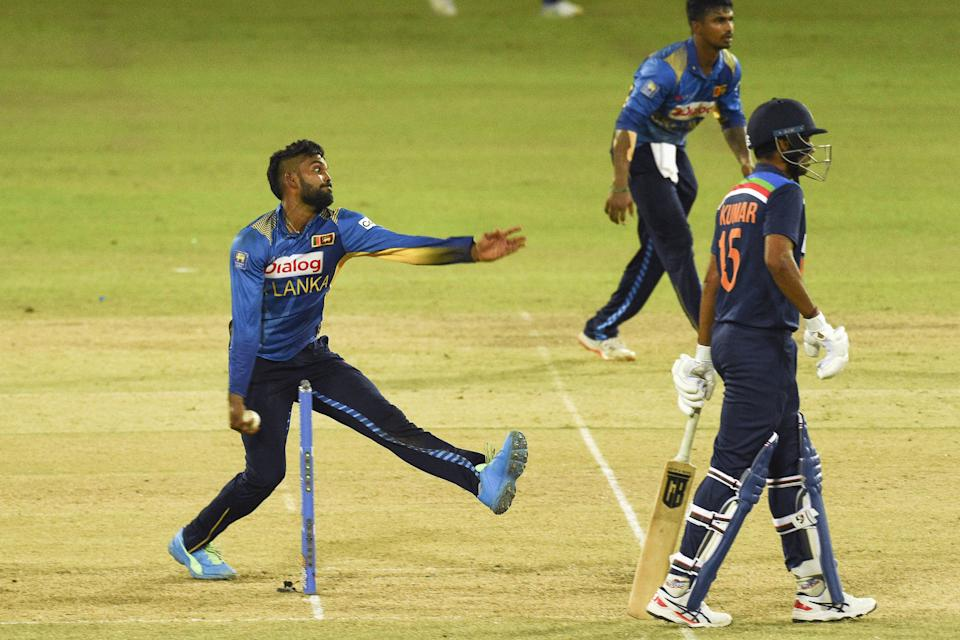 Sri Lanka's Wanindu Hasaranga (L) delivers a ball during the second one-day international (ODI) cricket match between Sri Lanka and India at the R.Premadasa Stadium in Colombo on July 20, 2021. (Photo by ISHARA S. KODIKARA / AFP) (Photo by ISHARA S. KODIKARA/AFP via Getty Images)