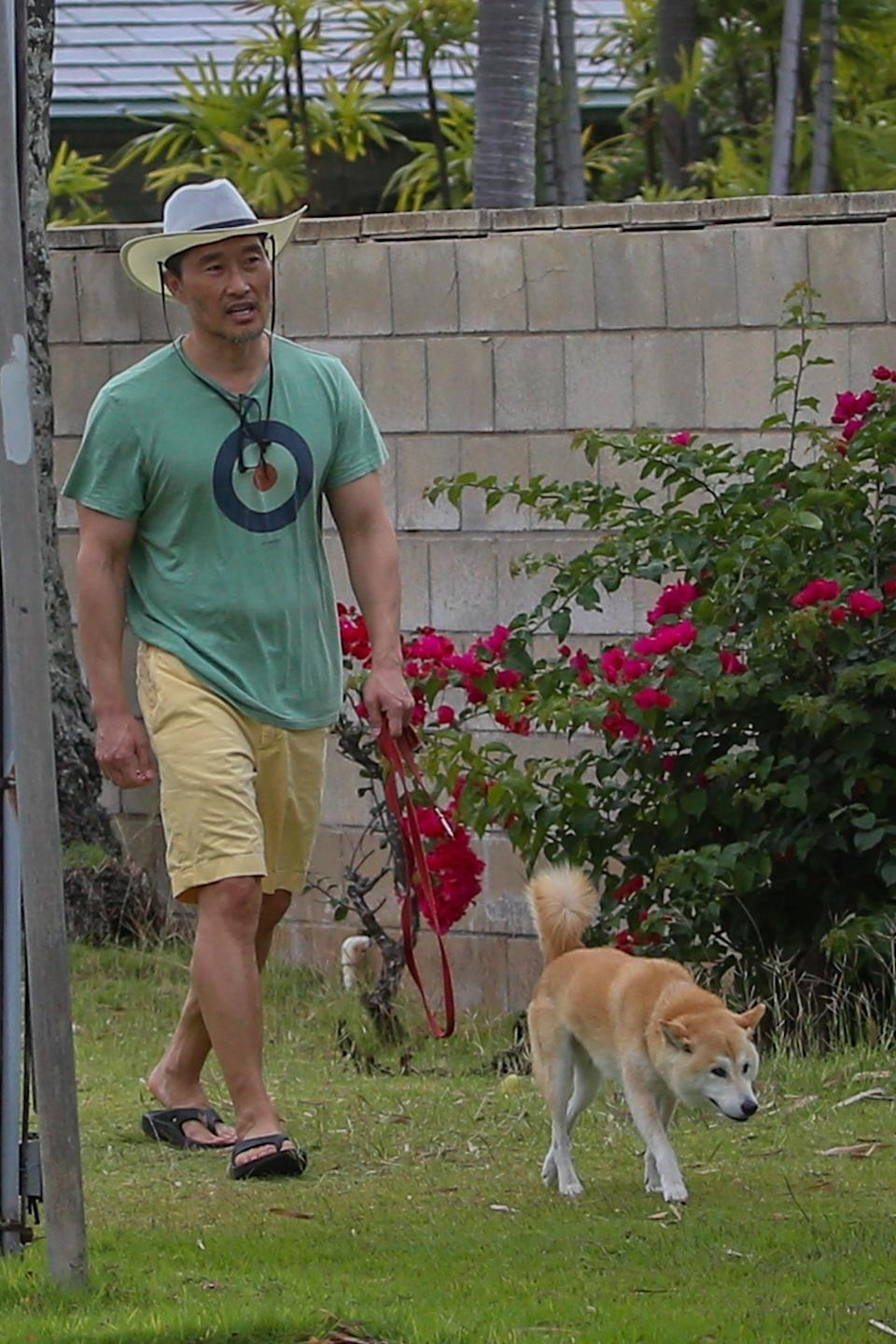 Daniel Dae Kim seen walking his dog outside on March 29 after recovering from COVID-19 and his 14 day quarantine.