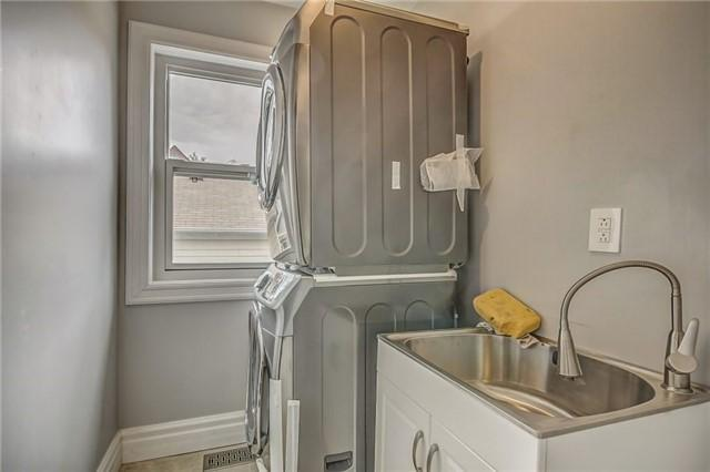 <p>6 William St., Brampton, Ont. The laundry room with stacked laundry unit is conveniently located on the main floor. (Photo: Zoocasa) </p>