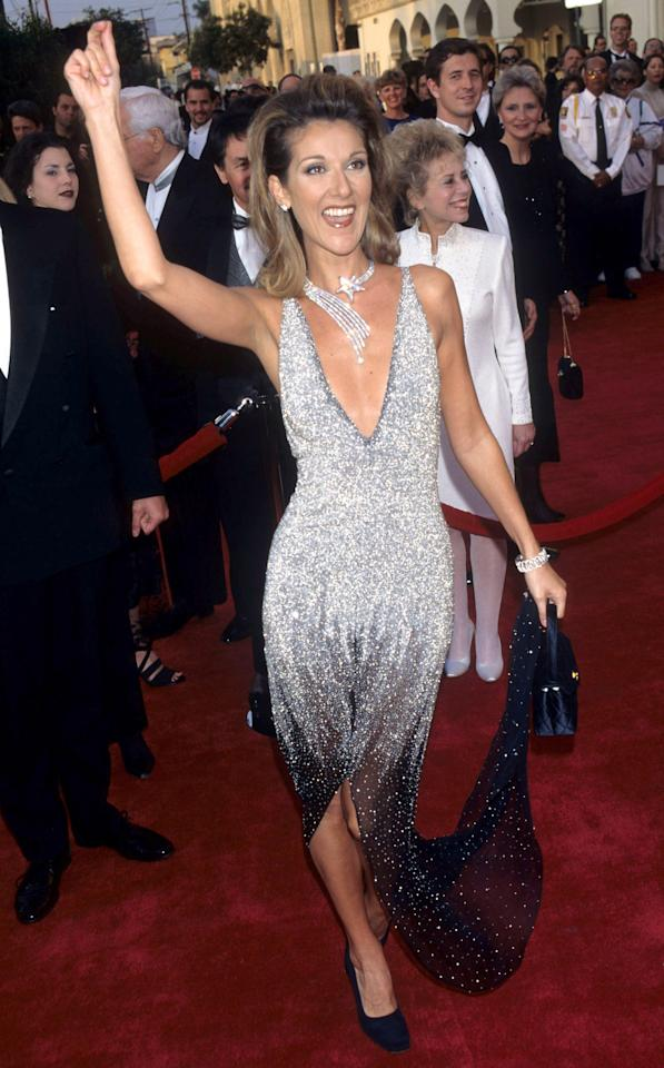 Dion kicked up the glitz at the 69th Annual Academy Awards in this Chanel couture dress with white, silver, and black stones. 1997. Photo courtesy of Getty Images.