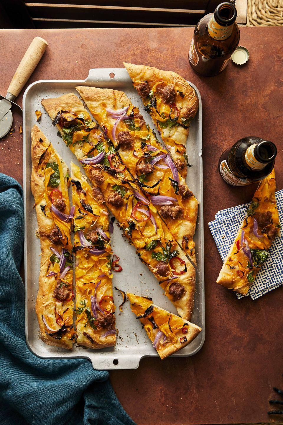 """<p>Hosting friends for pizza night? Give the meal a big fall boost with this smokey, savory dish. Shaved pumpkin is melt-in-your-mouth good, and pairs well with onion, chorizo, and sharp Cheddar cheese.</p><p><strong><a href=""""https://www.countryliving.com/food-drinks/a33944055/pumpkin-chorizo-pizza/"""" rel=""""nofollow noopener"""" target=""""_blank"""" data-ylk=""""slk:Get the recipe"""" class=""""link rapid-noclick-resp"""">Get the recipe</a>.</strong> </p>"""