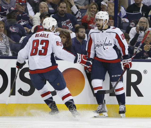 Washington Capitals' Chandler Stephenson, right, celebrates his goal against the Columbus Blue Jackets with teammate Jay Beagle during the third period of Game 6 of an NHL first-round hockey playoff series Monday, April 23, 2018, in Columbus, Ohio. The Capitals defeated the Blue Jackets 6-3. (AP Photo/Jay LaPrete)