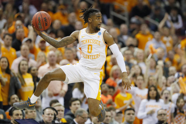 <p>Jordan Bone #0 of the Tennessee Volunteers throws a pass against the Tennessee Volunteers during the first half of the 2019 NCAA Men's Basketball Tournament South Regional at the KFC YUM! Center on March 28, 2019 in Louisville, Kentucky. (Photo by Kevin C. Cox/Getty Images) </p>
