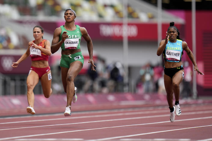 Blessing Okagbare, of Nigeria, wins a heat in the women's 100-meter run at the 2020 Summer Olympics, Friday, July 30, 2021, in Tokyo. (AP Photo/Petr David Josek)