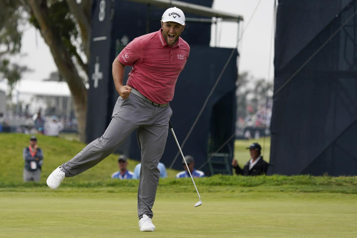 Jon Rahm, of Spain, reacts to his putt on the 17th green during the final round of the U.S. Open Golf Championship, Sunday, June 20, 2021, at Torrey Pines Golf Course in San Diego. (AP Photo/Marcio Jose Sanchez)