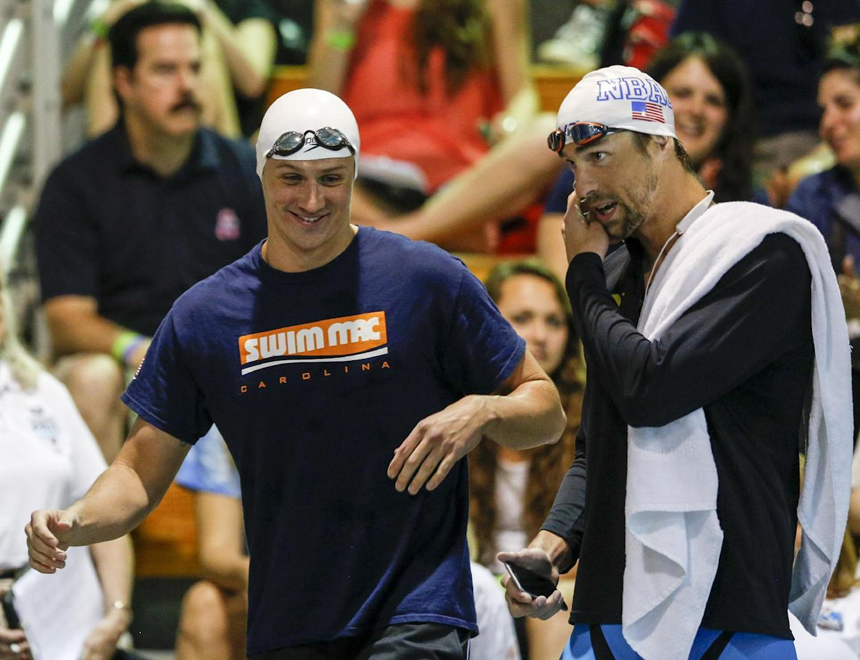 "A May 15, 2015, file photo, Ryan Lochte, left, and Michael Phelps talk before the start of the 100-meter butterfly final at the Arena Pro Swim Series meet in Charlotte, N.C. Add Phelps' name to the list of Americans who were less than amused by teammate Lochte's post-competition, early morning drunken antics at the Rio Olympics. ""I did have a talk with him about two days before about not doing anything bad,"" said Phelps, who retired after the Summer Games as the most-decorated Olympian of all time. ""I told him: `Just keep your head on straight. Have fun.'"" (AP Photo/Nell Redmond, File)"