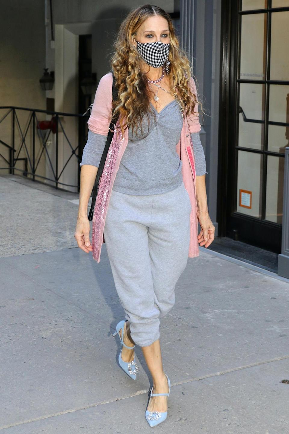 <p>Sarah Jessica Parker heads into her SJP By Sarah Jessica Parker store in Manhattan on Friday.</p>